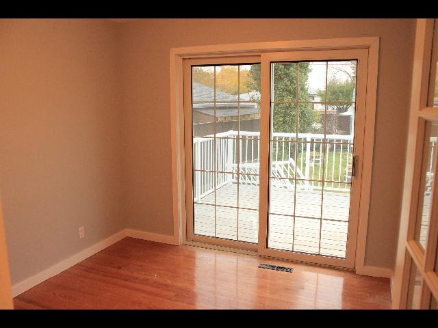 Third bedroom overlooks backyard with patio door to deck. Perfect for bedroom or den/office space.
