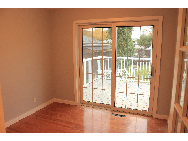 Third bedroom overlooks backyard with patio door to deck. Perfect for bedroom or den/office space.