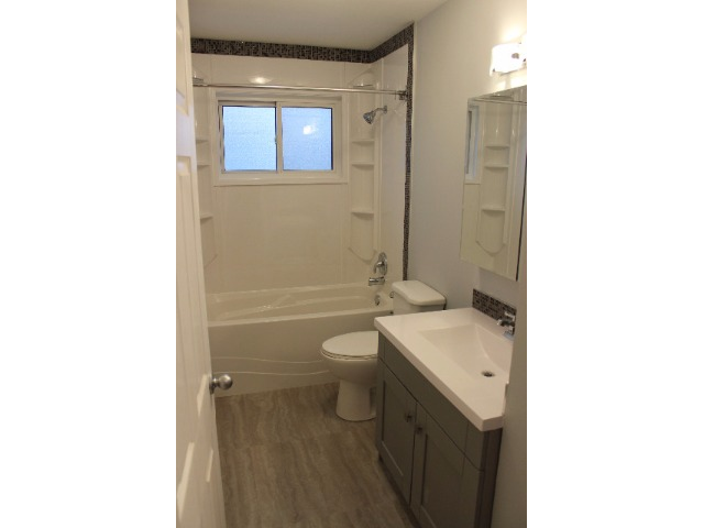 Four piece bathroom with rain shower and huge all mirrored medicine cabinet. Opens up to have loads of storage for makeup and other bathroom needs.